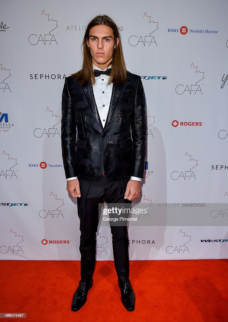 Model Travis Smith arrives at the 1st Annual Canadian Arts and Fashion Awards at the Fairmont Royal York Hotel on February 1, 2014 in Toronto, Canada.