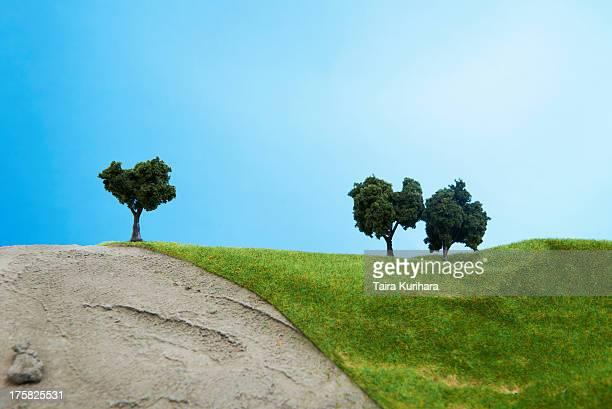 Model trees on pretend grass