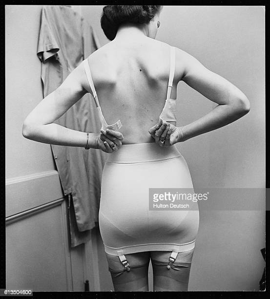 A model tries on a combination of the new Sarong foundation wear ca 1955