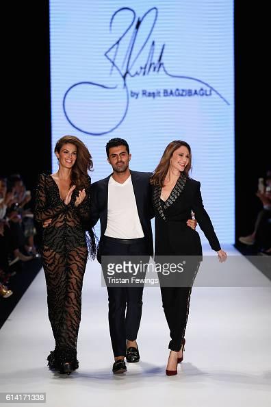 Model Tulin Sahin designer Rasit Bagzibagli and Demet Sener walk the runway at the Rasit Bagzibagli show during MercedesBenz Fashion Week Istanbul at...