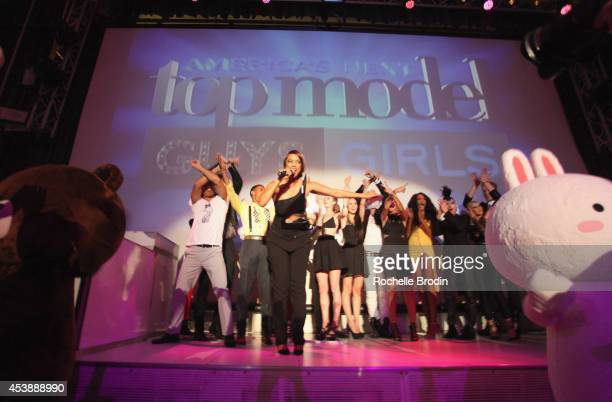 Model Tyra Banks and Cycle 21 models speak onstage at America's Next Top Model Cycle 21 premiere party presented by NYLON and LINE at SupperClub Los...