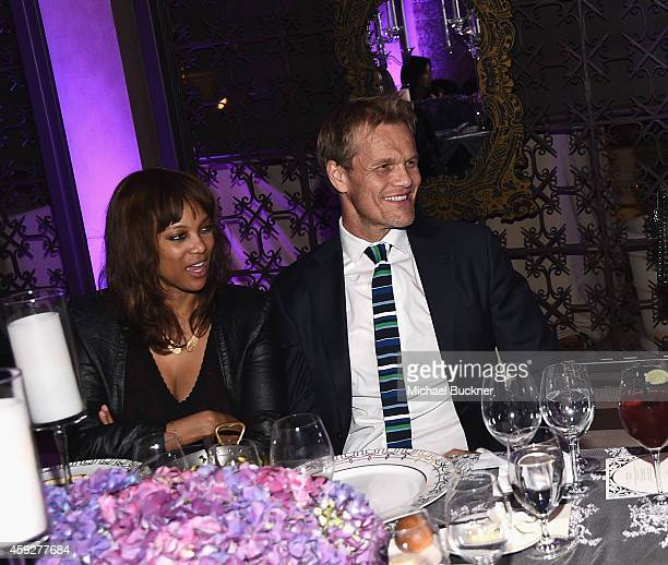 Model Tyra Banks and photographer Erik Asla attends the August Getty Atelier Dinner at the Montage Hotel Rooftop Grill on November 19 2014 in Beverly...