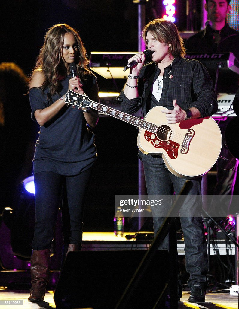 Model Tyra Banks (L) and singer Billy Ray Cyrus appear onstage at Miley Cyrus' 'Sweet 16' birthday celebration benefiting Youth Service America at Disneyland on October 5, 2008 in Anaheim, California.