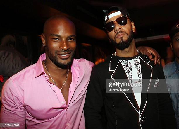 Model Tyson Beckford and musician Swizz Beatz attend the VIBE 20th Anniversary Celebration at No 8 on August 23 2013 in New York City