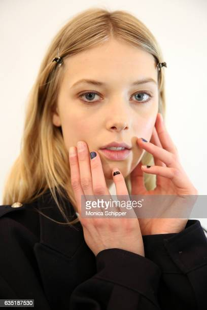 Model Ulrikke Hoyer prepares backstage at the Zadig Voltaire fashion show during New York Fashion Week at Skylight Modern on February 13 2017 in New...