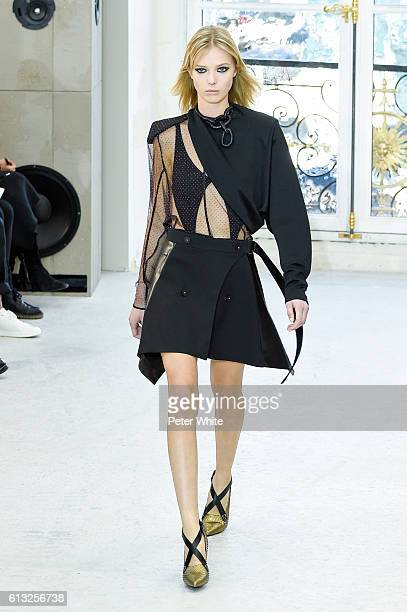 Model Ulrikke Hoyer walks the runway during the Louis Vuitton show as part of the Paris Fashion Week Womenswear Spring/Summer 2017 on October 5 2016...