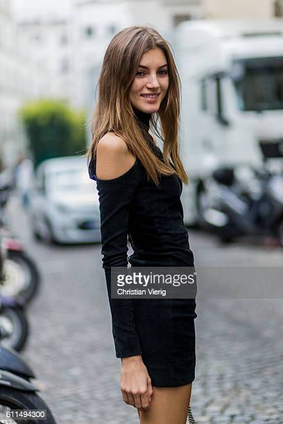 Model Valery Kaufman wearing a black dress outside Balmain on September 29 2016 in Paris France