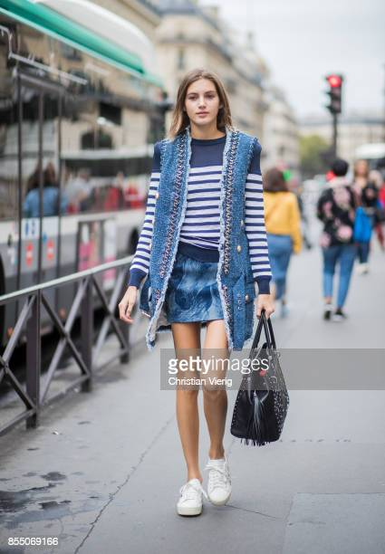 Model Valery Kaufman wearing a striped knit vest is seen outside Balmain during Paris Fashion Week Spring/Summer 2018 on September 28 2017 in Paris...