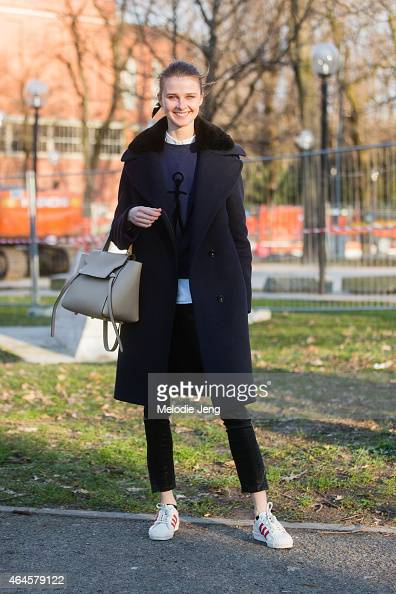 Model Vasilisa Pavlova wears a JW Anderson sweatshirt Celine bag and Adidas Originals sneakers on February 26 2015 in Milan Italy