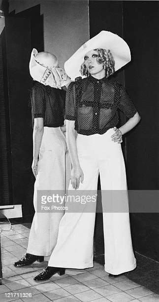 Model Vicki Wisse wearing 'Suddenly Last Summer' from Alice Pollock's new collection on show in London 18th January 1968 Wide leg white trousers are...