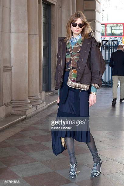 KINGDOM FEBRUARY 21 Model Victoria Sekrier wearing Kat Maconey shoes vintage shirt Angela Jackson bag Hugo Boss sunglasses street style at London...