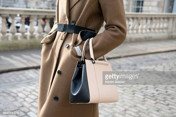 Model Victoria Sekrier wears a Dagma coat Giano bag on day 3 of London Collections Women on February 22 2015 in London England