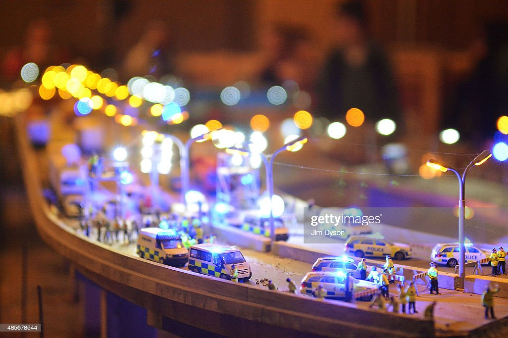 A model village by artist Jimmy Cauty depicts a miniature Police State called 'Aftermath Displacement Principle', as Banksy's Dismaland Bemusement Park opens to the public, on August 28, 2015 in Weston-Super-Mare, England. Graffiti artist Banksy has opened the subversive, pop-up theme park styled exhibition at the derelict seafront Tropicana lido, featuring the work of 50 artists. The 'Bemusement Park' combines dark humour and 'entry-level anarchism' and will open for just five weeks.
