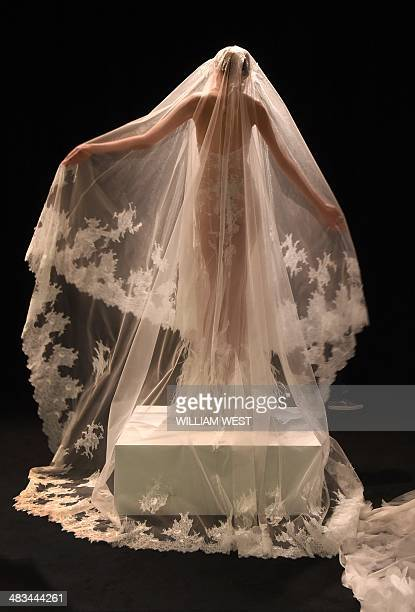 A model waers a bridal outfit by Chinese designer Lan Yu at Fashion Week Australia in Sydney on April 9 2014 The fourday schedule will include a...