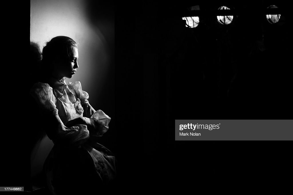 A model waits backstage ahead of the MBFWA Trends show during Mercedes-Benz Fashion Festival Sydney 2013 at Sydney Town Hall on August 23, 2013 in Sydney, Australia.