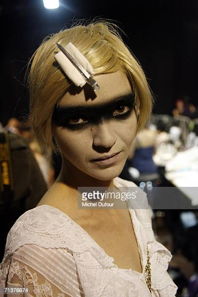 A model waits backstage at the Christian Dior Fashion show is shown during Paris Fashion Week FallWinter 2006/07 at Polo de Paris on July 5 2006 in...