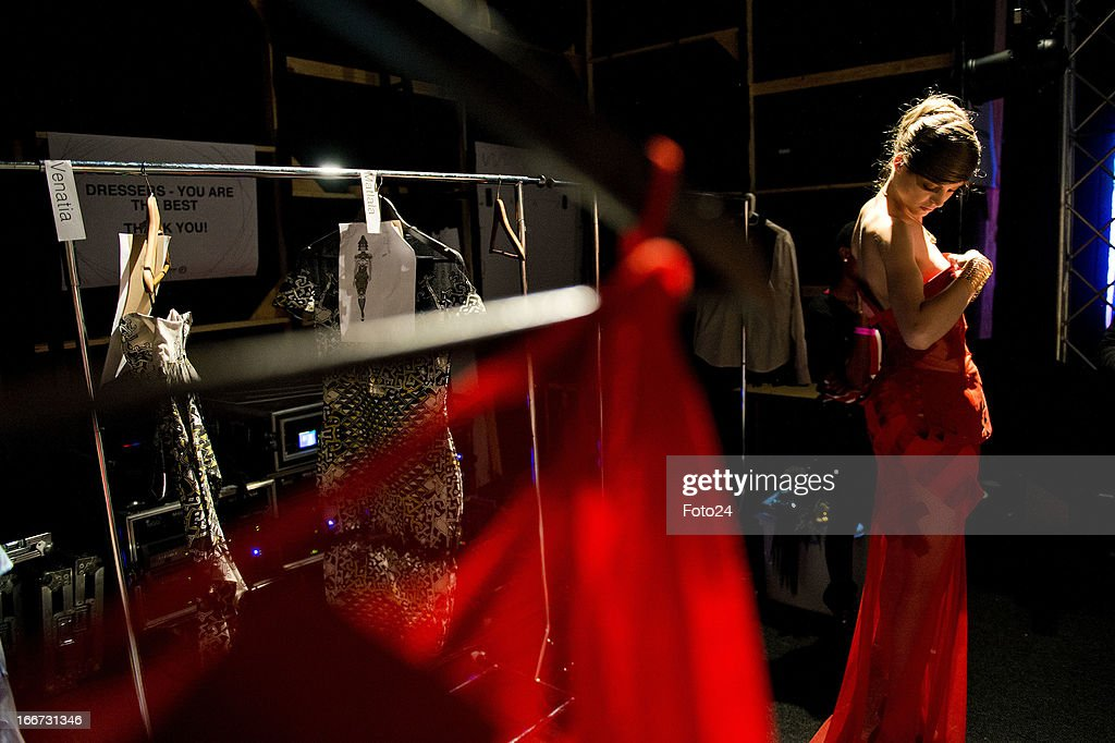 A model waits backstage before the Black Coffee show at SA Fashion Week at the Crowne Plaza on April 12, 2013, in Johannesburg, South Africa.