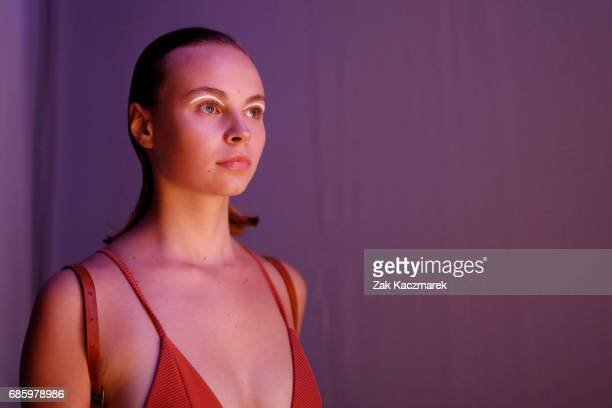 A model waits backstage before walking the runway during MercedesBenz Fashion Week Weekend Edition at Carriageworks on May 20 2017 in Sydney Australia