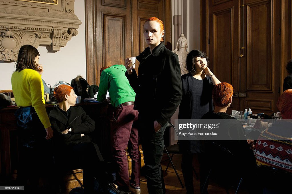 A model waits backstage during the Songzio Men Autumn / Winter 2013 show as part of Paris Fashion Week on January 19, 2013 in Paris, France.