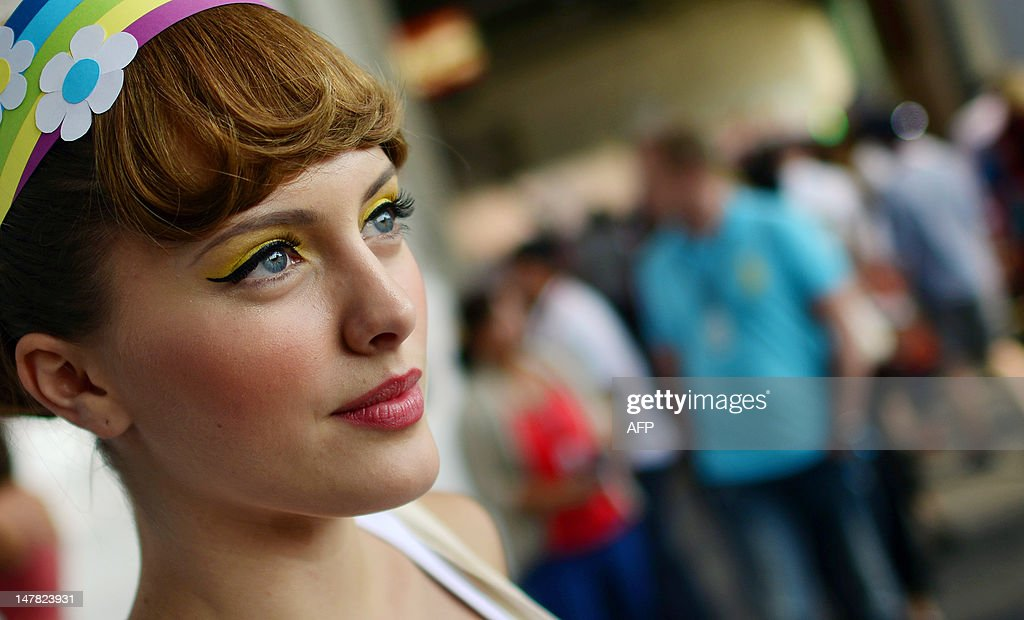 A model waits beside a booth at the fashion fair 'Bread & Butter' at the former airport Tempelhof show on the sidelines of the Spring/Summer 2013 shows of the Mercedes-Benz Fashion Week Berlin on July 4, 2012.
