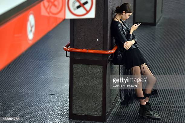 A model waits in the metro station after the Dolce Gabbana show during the 2015 Spring / Summer Milan Fashion Week on September 21 2014 in Milan AFP...