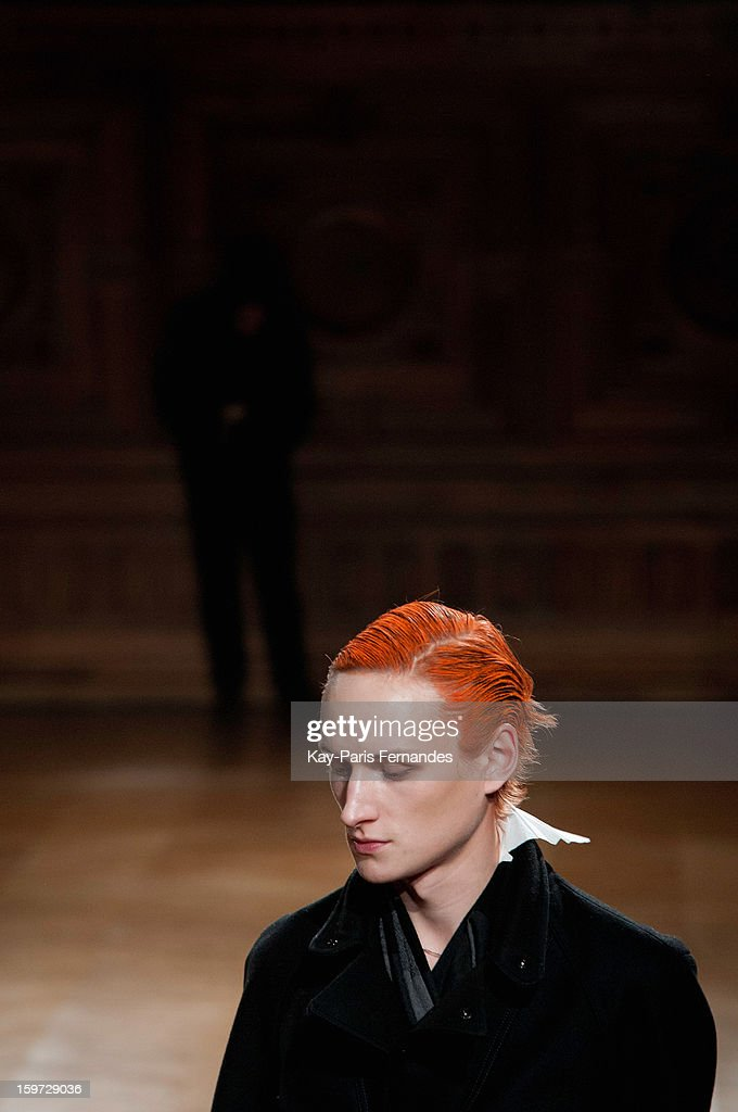 A model waits on the runway before the Songzio Men Autumn / Winter 2013 show as part of Paris Fashion Week on January 19, 2013 in Paris, France.