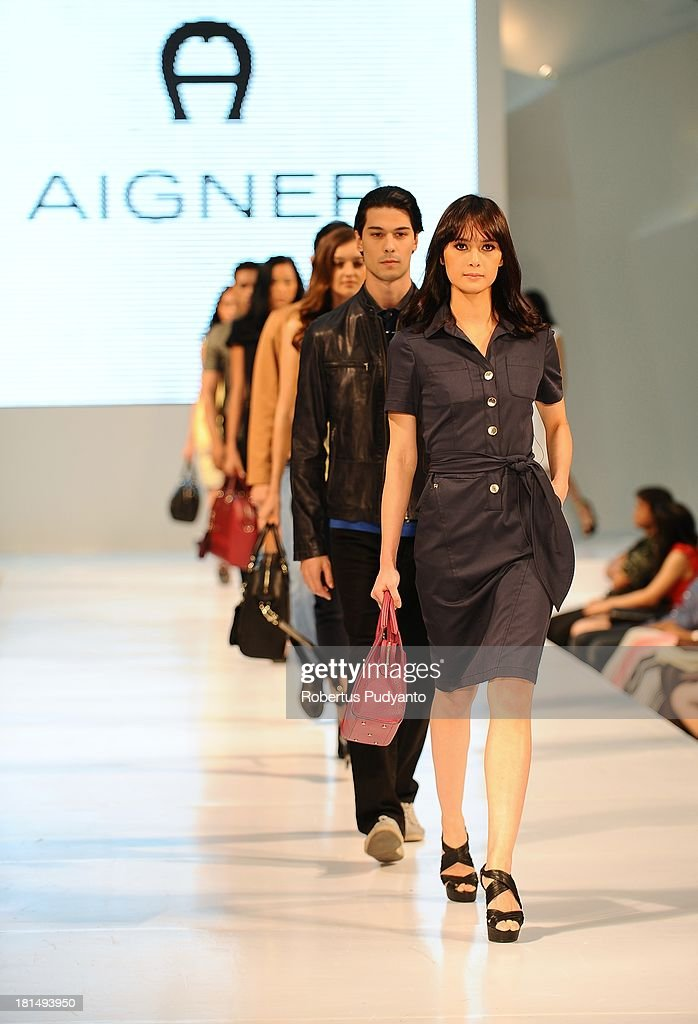 Model walk the runway at Aigner Autumn Winter Leather 2013 Collection show during Ciputra World Fashion Week on September 21, 2013 in Surabaya, Indonesia.