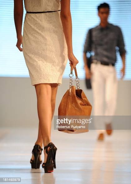 Model walk the runway at Armani Jeans fashion show during Ciputra World Fashion Week on September 21 2013 in Surabaya Indonesia