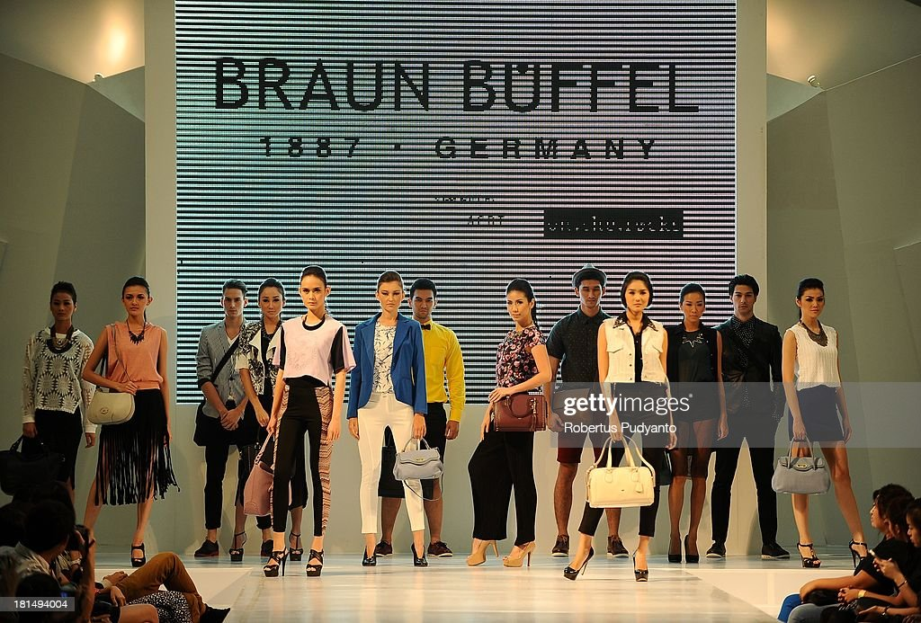 Model walk the runway at Braun Buffel fashion show during Ciputra World Fashion Week on September 21, 2013 in Surabaya, Indonesia.