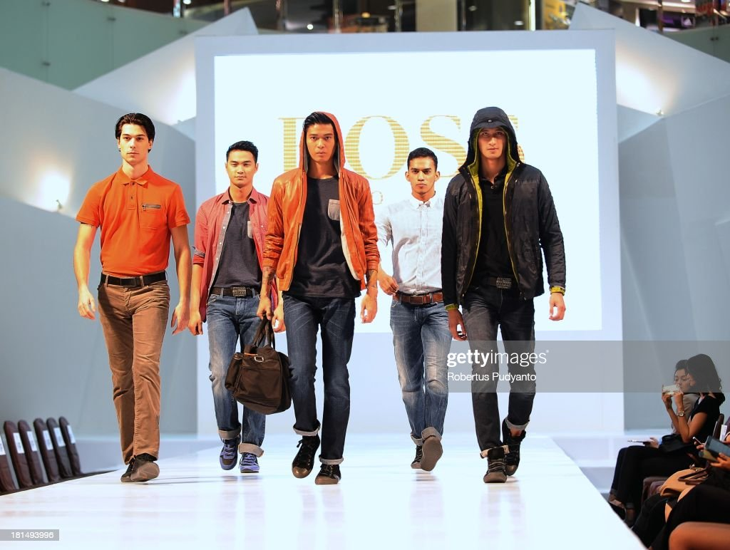 Model walk the runway at Hogo Boss fashion show during Ciputra World Fashion Week on September 21, 2013 in Surabaya, Indonesia.