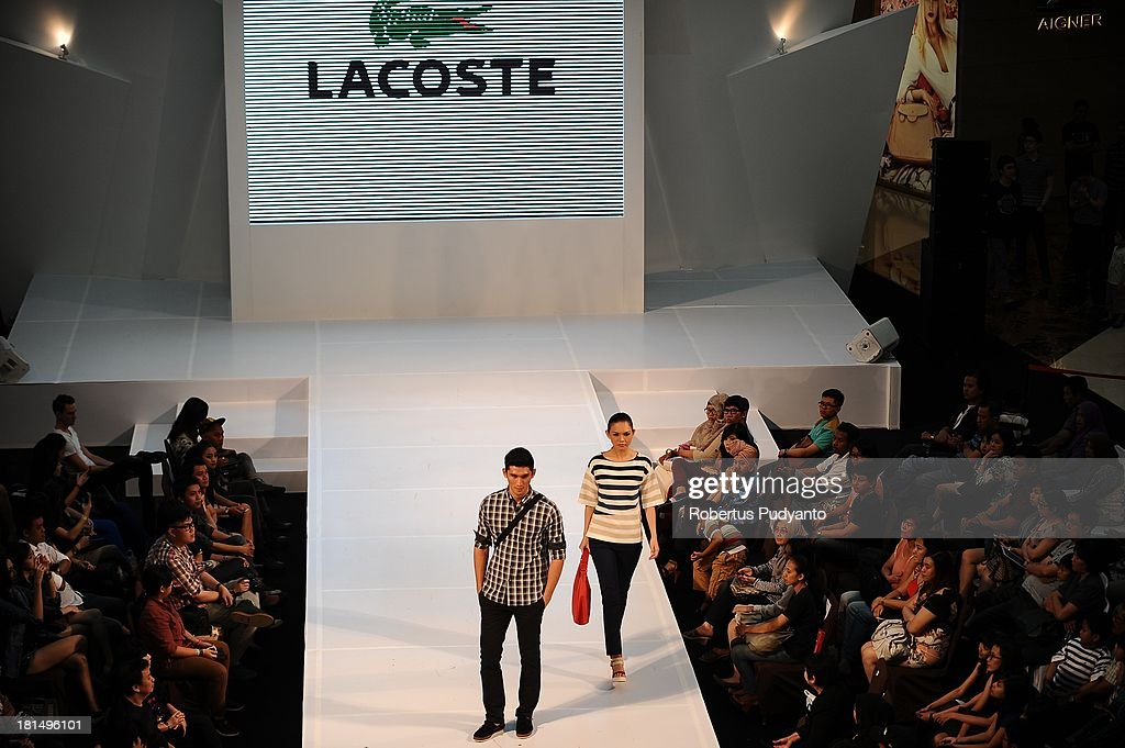 Model walk the runway at Lacoste show during Ciputra World Fashion Week on September 21, 2013 in Surabaya, Indonesia.