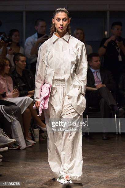 A model walk the runway at the Minna Palmqvist show at Fashion Week in Stockholm SS 15 on August 27 2014 in Stockholm Sweden