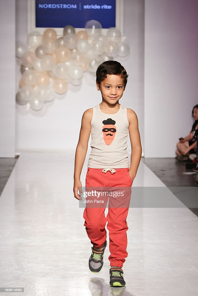 A model walk the runway at the Nordstrom Stride Rite Show during the petiteParade NY Kids Fashion Week in Collaboration with VOGUEbambini at Industria Superstudio on October 6, 2013 in New York City.