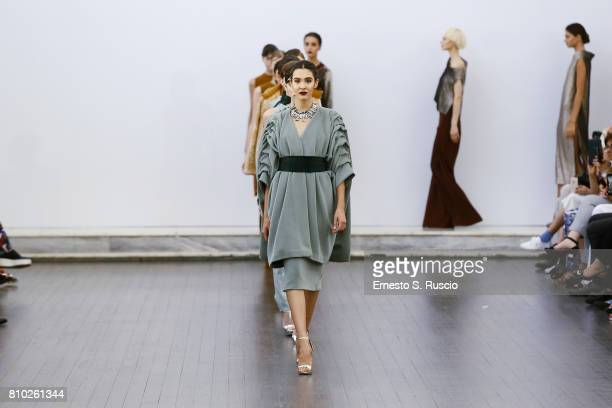 Model walk the runway at the Sabrina Persechino Show during Altaroma on July 7 2017 in Rome Italy