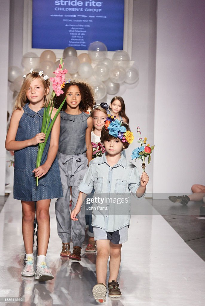 A model walk the runway at the Stride Rite Show finale during the petiteParade NY Kids Fashion Week in Collaboration with VOGUEbambini at Industria Superstudio on October 6, 2013 in New York City.