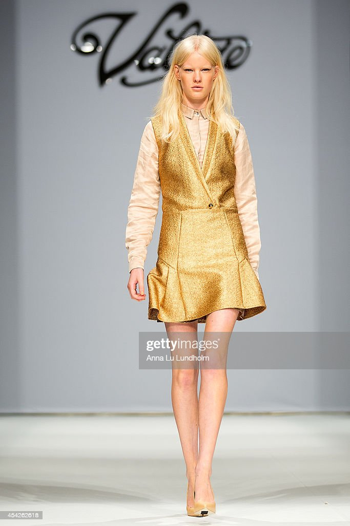 A model walk the runway at the Valerie show at Fashion Week in Stockholm SS 15 on August 27, 2014 in Stockholm, Sweden.
