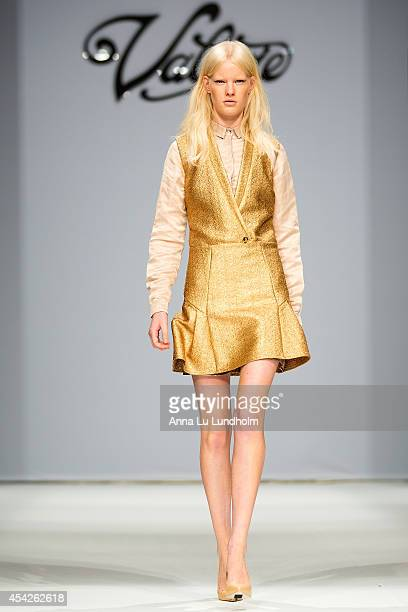 A model walk the runway at the Valerie show at Fashion Week in Stockholm SS 15 on August 27 2014 in Stockholm Sweden