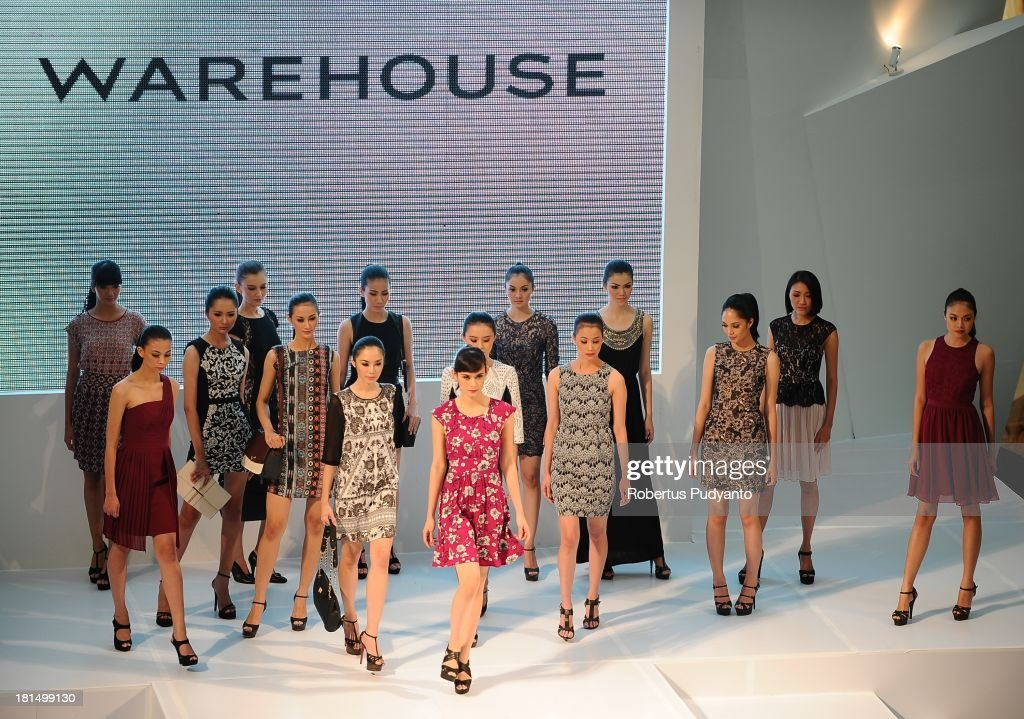 Model walk the runway at Warehouse Collection show during Ciputra World Fashion Week on September 21, 2013 in Surabaya, Indonesia.