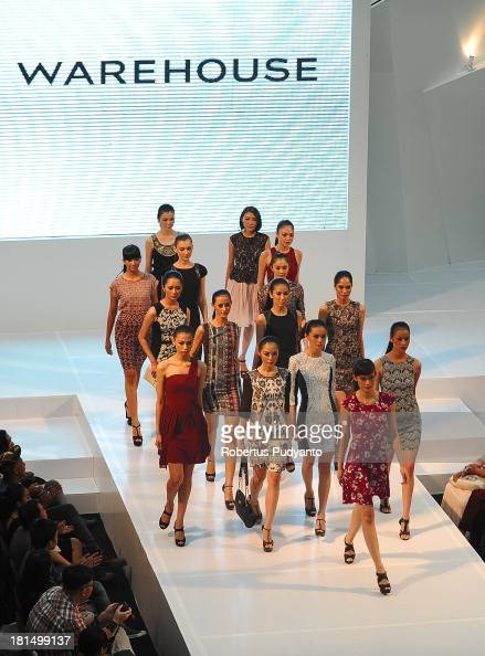 Model walk the runway at Warehouse Collection show during Ciputra World Fashion Week on September 21 2013 in Surabaya Indonesia