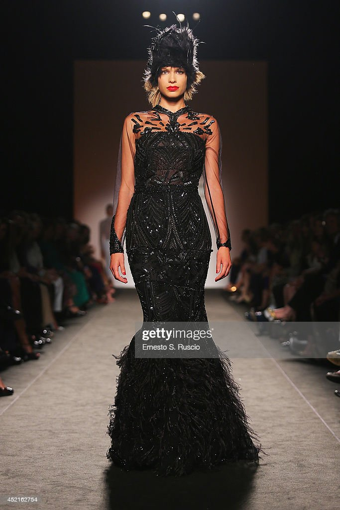 Model walk the runway during Curiel Couture F/W 2014-2015 Italian Haute Couture colletion fashion show as part of AltaRoma AltaModa Fashion Week at Santo Spirito In Sassia on July 14, 2014 in Rome, Italy.