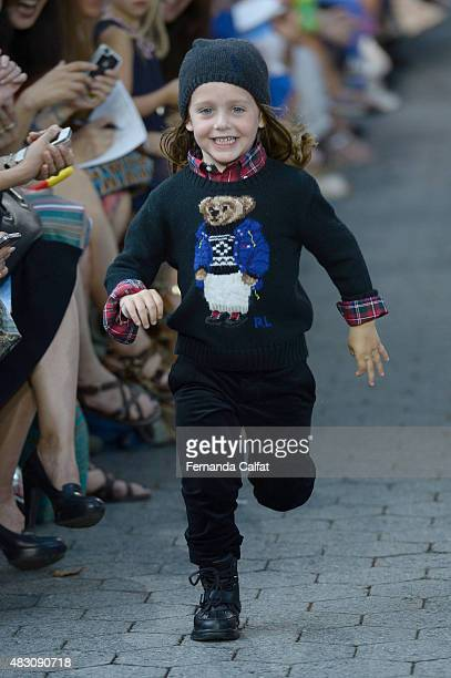 A model walks at Ralph Lauren Children's Fashion Show at Central Park Zoo on August 5 2015 in New York City