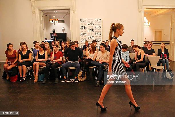A model walks before the judges as other models sit and wait to walk during the David Jones Melbourne Model Casting on July 8 2013 in Melbourne...