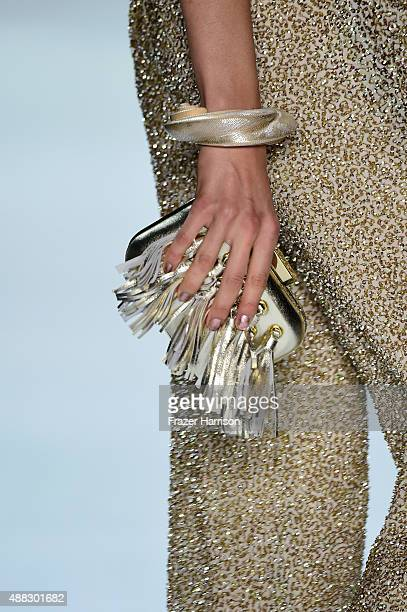 A model walks clutch detail the runway wearing Badgley Mischka Spring 2016 during New York Fashion Week The Shows at The Arc Skylight at Moynihan...