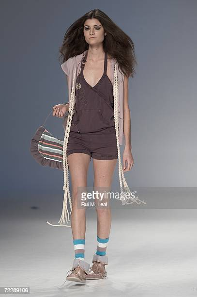 Model walks down the catwalk at Concreto by Susana Santos e Helder Baptista fashion show on the third day of the Portugal Fashion Week on October 27...