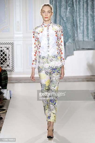 A model walks down the catwalk during the Erdem show at London Fashion Week Spring/Summer 2012 on September 19 2011 in London United Kingdom