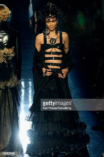 A model walks down the catwalk during the JeanPaul Gaultier Retro Fashion Show as part of Paris Fashion Week Spring/Summer 2007 on October 3 2006 in...