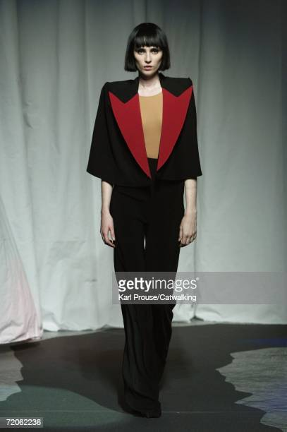 A model walks down the catwalk during the Maison Martin Margiela Fashion Show as part of Paris Fashion Week Spring/Summer 2007 on October 1 2006 in...