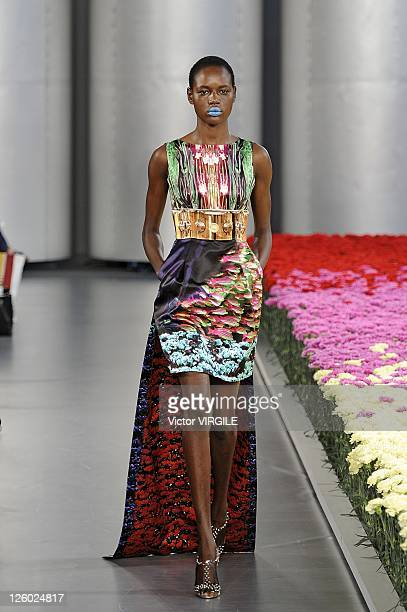 A model walks down the catwalk during the Mary Katrantzou Runway show at London Fashion Week Spring/Summer 2012 on September 20 2011 in London United...