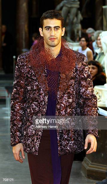 A model walks down the catwalk wearing a skirt designed by a renowned designer February 27 2002 during the ''Men in Skirts'' Fashion show as part of...