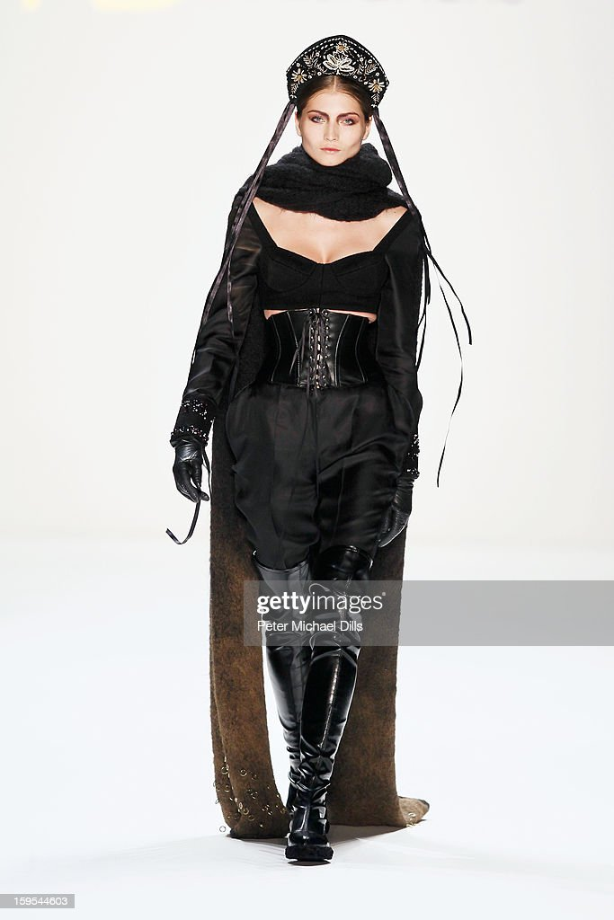 A model walks down the runway at Adelina Ivan, Andra Clitan, Stephan Pelger Autumn/Winter 2013/14 fashion show during Mercedes-Benz Fashion Week Berlin at Brandenburg Gate on January 15, 2013 in Berlin, Germany.